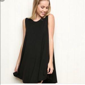 Black Brandy Melville sleeveless shift dress.